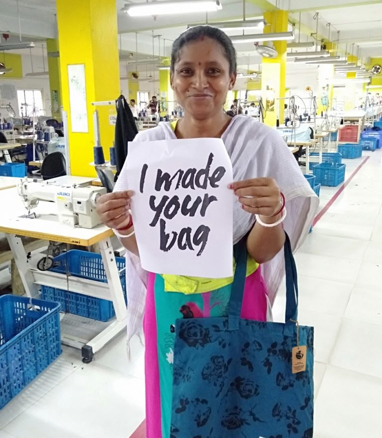 Indian lady holding i made your bag sign